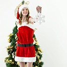 A woman wearing Santa Claus clothes
