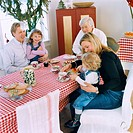 Family sitting at table with checked tablecloth