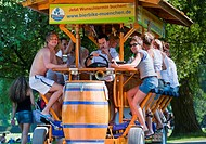 A German mobile bar where you cycle as you drink beer, in Munich's Englischer garten, Germany