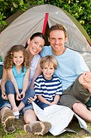 Adorable family camping in the garden
