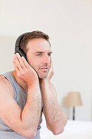 Handsome man listening to some music