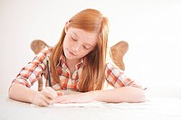 Red headed girl doing her homework