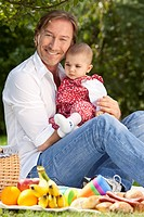 Germany, Bavaria, Father and baby girl 2_5 months having picnic