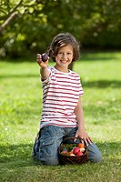 Germany, Girl 8_9 Years smiling with easter egg basket, portrait