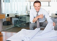 Architect reviewing blueprints in office