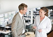 Businessman talking to scientist in office