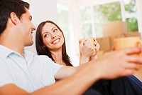 Couple taking coffee break in new house