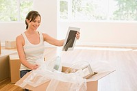 Woman unpacking picture in new house