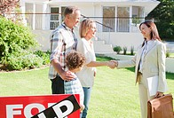 Realtor congratulating family on buying their new house