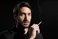 Young man with cigarette, portrait