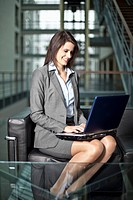 Germany, Bavaria, Business woman using laptop