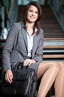 Germany, Bavaria, Business woman smiling, portrait