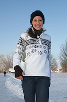 Germany, Bavaria, Woman ice skating, smiling