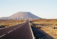 Lonely road and volcano. Fuerteventura island, Canary Islands, Spain