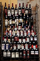 Bottles of Bardolino wine on display outside a vintners shop