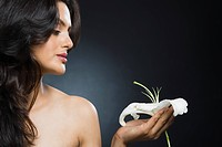 Woman holding a Tiger Lily flower