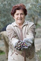 Older woman with olives