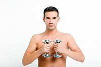 Young man with hand weights