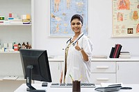 Female doctor showing thumbs up sign
