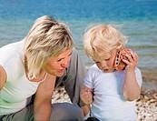 Croatia, Zadar, Mother and son on beach