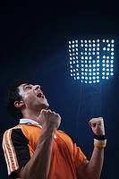 Soccer player clenching fist and shouting