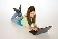 Teenage girl working on laptop computer