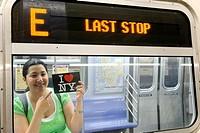 Hispanic, Asian, woman holding ´I Love New York´ postcard, Subway train metro station, New York City