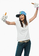Portrait of a female cricket fan cheering