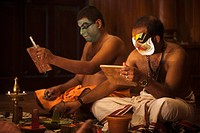Men applying make_up for Kathakali performance, Kochi, Kerala, India