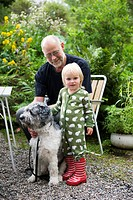 Senior man and girl with dog