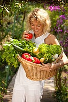 Woman vegetables basket