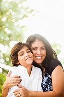Mixed race mother hugging son