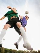 Soccer players heading soccer ball