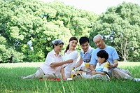 Happy family having picnic at the park