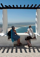 Couple looking at Nazare town in prata coast, portugal