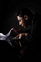 Businessman calculating a long list of bill