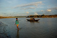 Fisherman returns after fishing in the Padma River in Pabna, Bangladesh 5 October 2009
