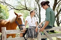 Couple with a horse at a ranch