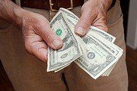 Older Man's Hands Holding Dollar Bills II