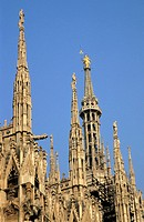 Iconic white pointed Gothic spires of the Milan Cathedral, Milan, Italy