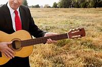 Businessman playing a guitar
