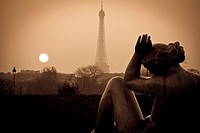 Eiffel Tower and sculptures at sunset from Tuileries Garden  Paris, France