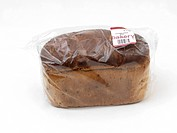 Loaf Of Brown Bread Wrapped In Plastic