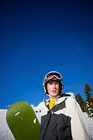 Portrait of an adolescent male snowboarder on Mt. Hood, Oregon.