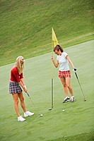 Women in their early 20s playing golf