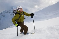 Young woman ski_touring in mountains.