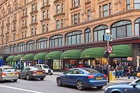 Front facade of Harrods, luxury department store, London, England
