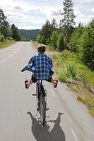 Boy on bike. North of Sweden