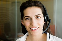 Woman wearing telephone headset, portrait