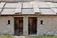 Italy, Trento, Levico, Plateau Vezzena, Malga Fratte Rustic mountain building used as a stable for the herd and home to the shepherds during the summe...